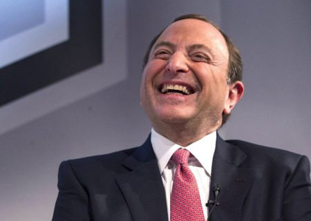 """NHL commissioner Gary Bettman laughs at a news conference in Toronto on Tuesday, Nov. 26, 2013. Rogers Communications wrested control of NHL multimedia rights with a blockbuster 12-year, $5.2-billion agreement that will preserve """"Hockey Night in Canada"""" but limit CBC's role in the iconic broadcast. THE CANADIAN PRESS/Chris Young"""