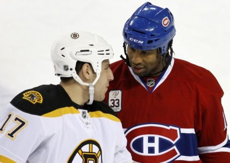 Montreal Canadiens' Georges Laraque (R) speaks with Boston Bruins' Milan Lucic during the first period of their NHL hockey game in Montreal November 22, 2008. REUTERS/Mathieu Belanger (CANADA)