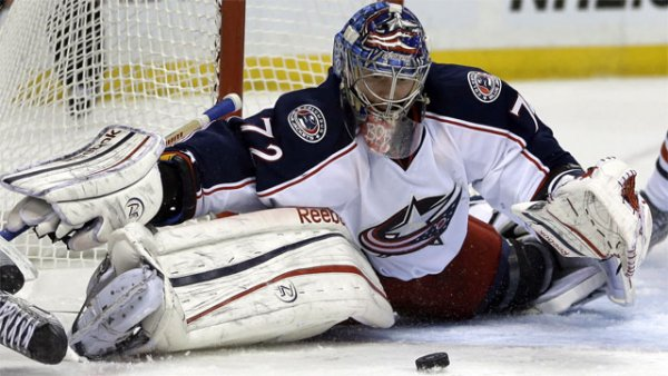 Columbus Blue Jackets goalie Sergei Bobrovsky, of Russia, makes a save during the second period of an NHL hockey game against the St. Louis Blues on Saturday, Feb. 23, 2013, in St. Louis. (AP Photo/Jeff Roberson)