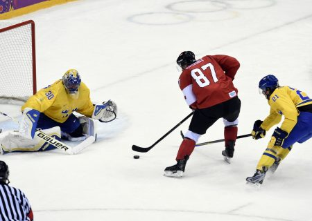 Feb 23, 2014; Sochi, RUSSIA; Canada forward Sidney Crosby (87) scores a goal against Sweden goalie Henrik Lundqvist (30) and forward Loui Eriksson (21) in the second period in the men's ice hockey gold medal game during the Sochi 2014 Olympic Winter Games at Bolshoy Ice Dome. Mandatory Credit: Scott Rovak-USA TODAY Sports